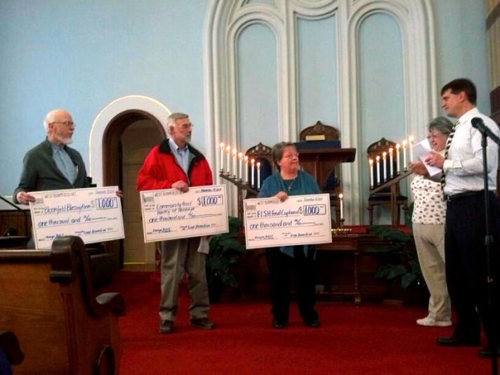 Photo of food cupboard check presentation at West Bloomfield Congregational Church